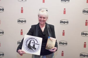 Ruth accepting award in Austin, Texas at IBPA